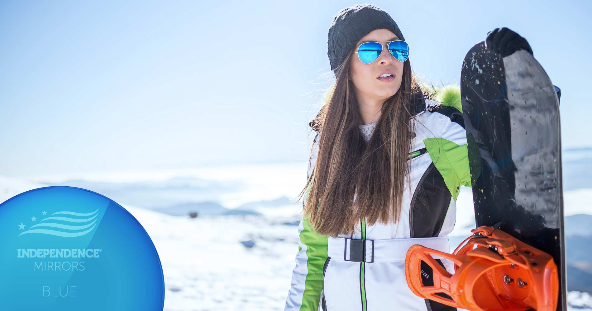 Young woman with a snowboard wearing blue-colored mirrored sunglasses