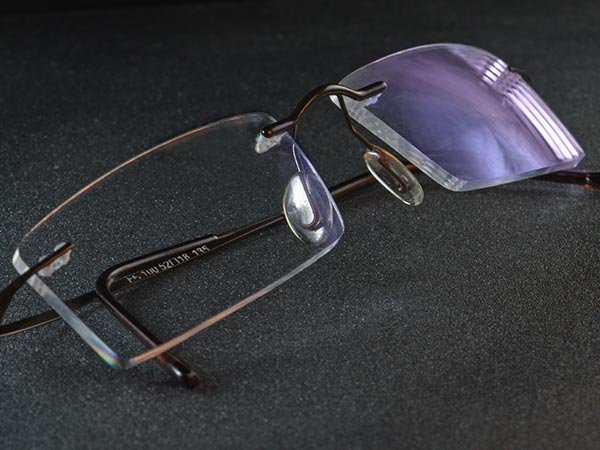 Pair of eye glasses with an anti-reflective coating showing the reflex-color blue