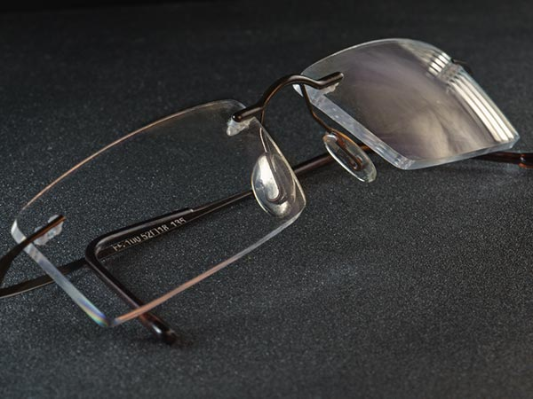 Pair of eye glasses with an anti-reflective coating showing the reflex-color gold