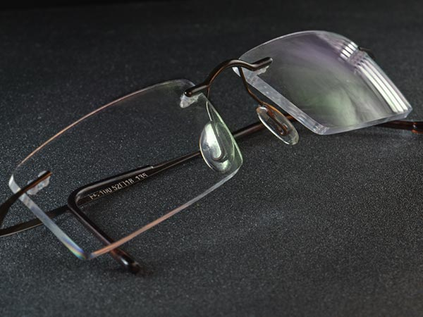 Pair of eye glasses with an anti-reflective coating showing the reflex-color green
